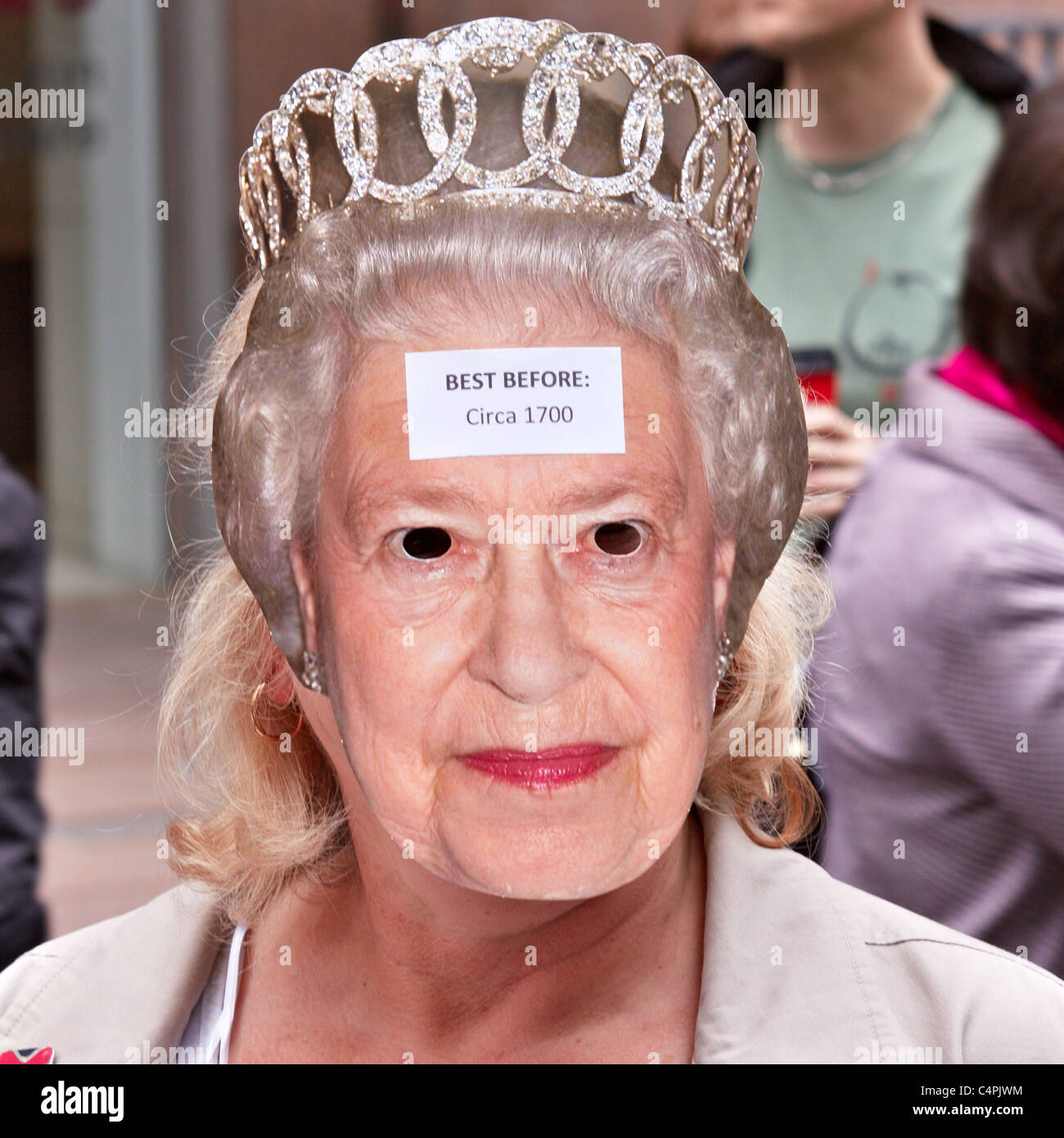 Royal Wedding 2011: A supporter of turning the UK in a republic wears a Queen Mask with a best before the year 1700 Stock Photo