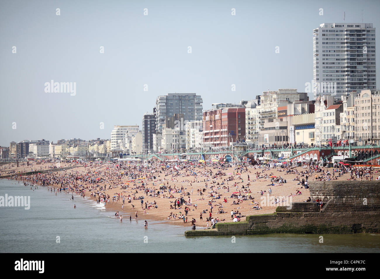 Busy Brighton beach on a hot summers day.  Picture by James Boardman. - Stock Image