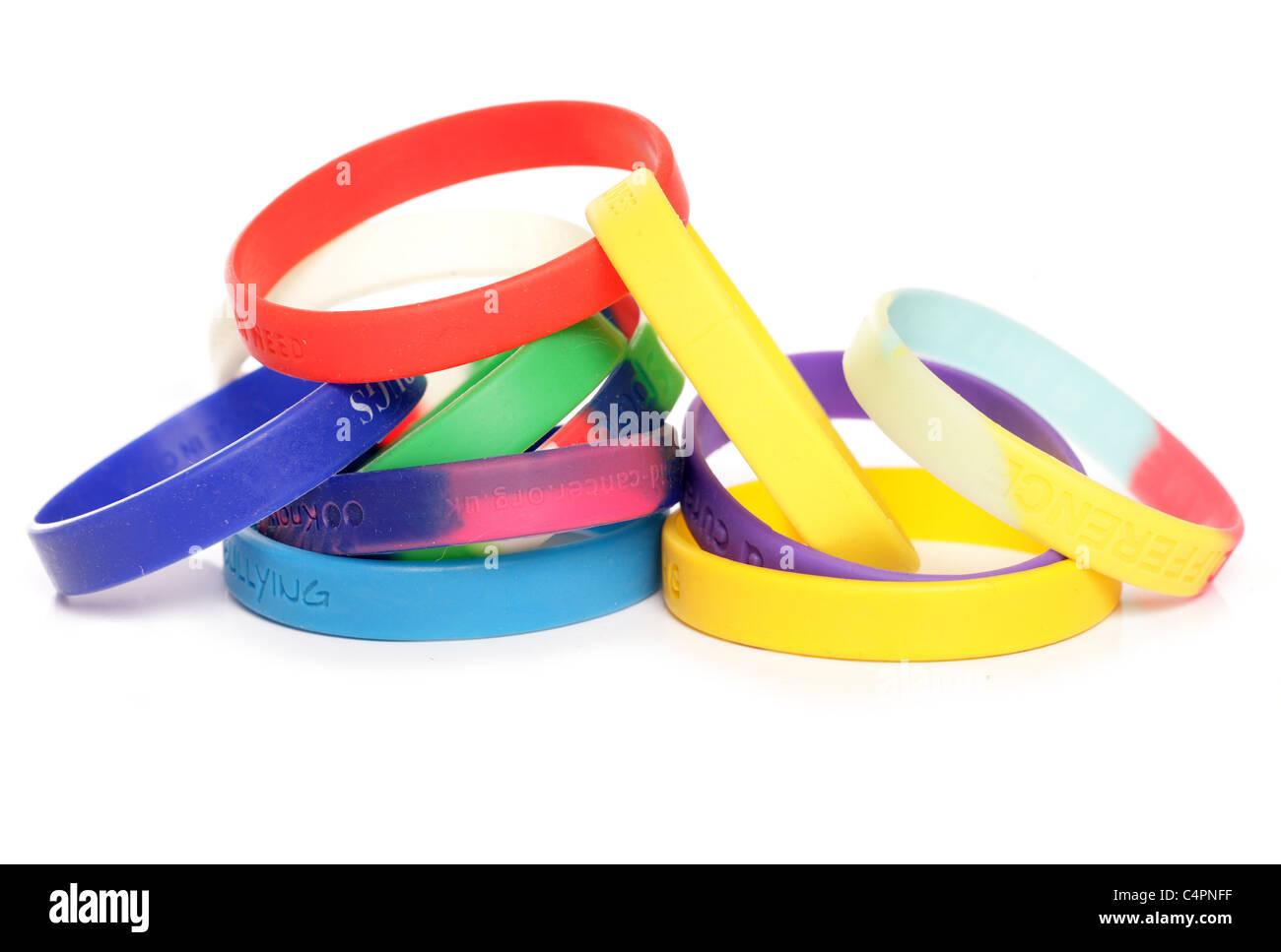 Various charity fundraising wristbands studio cutout - Stock Image