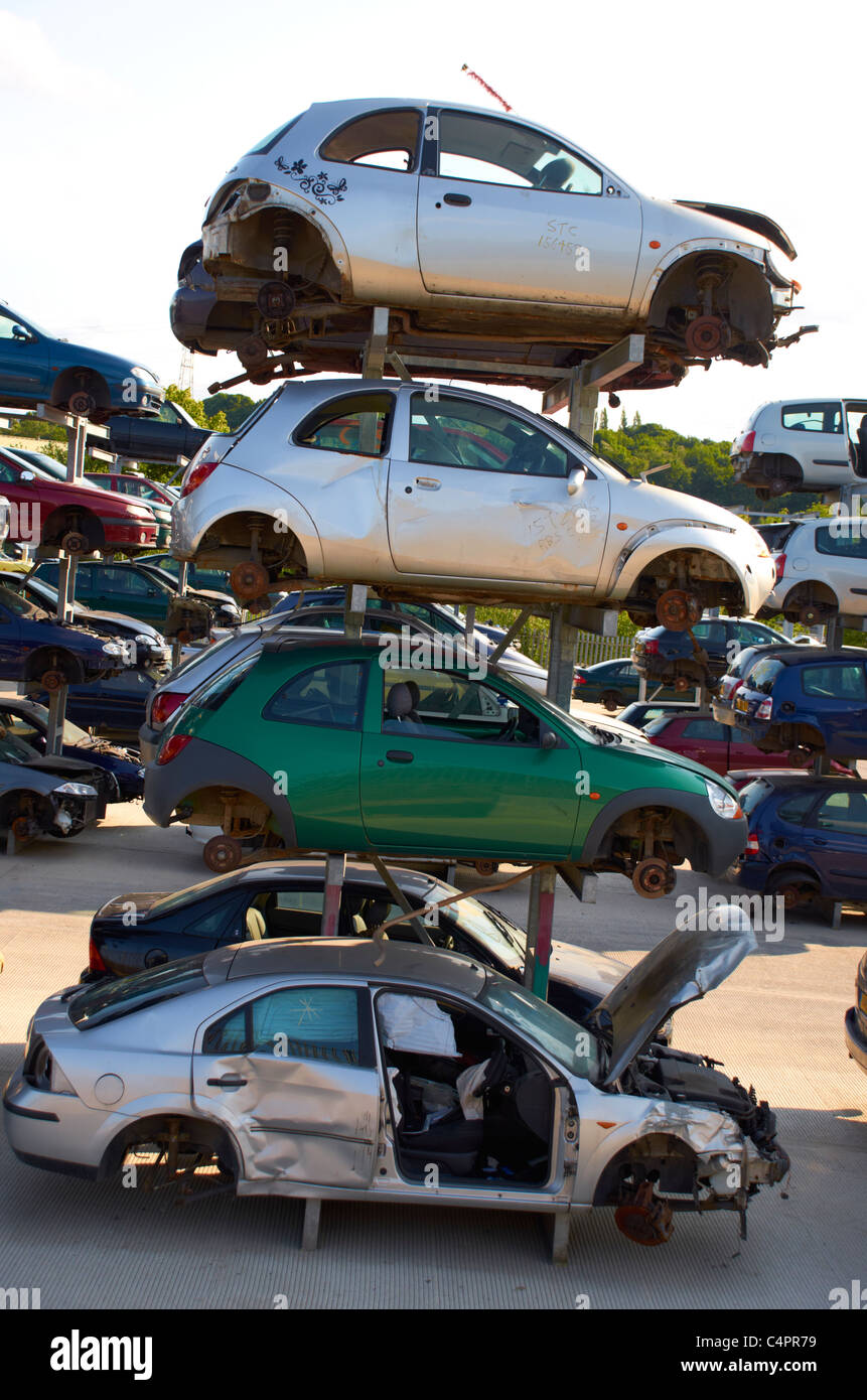 Cars stacked up in a scrapyard. Stock Photo