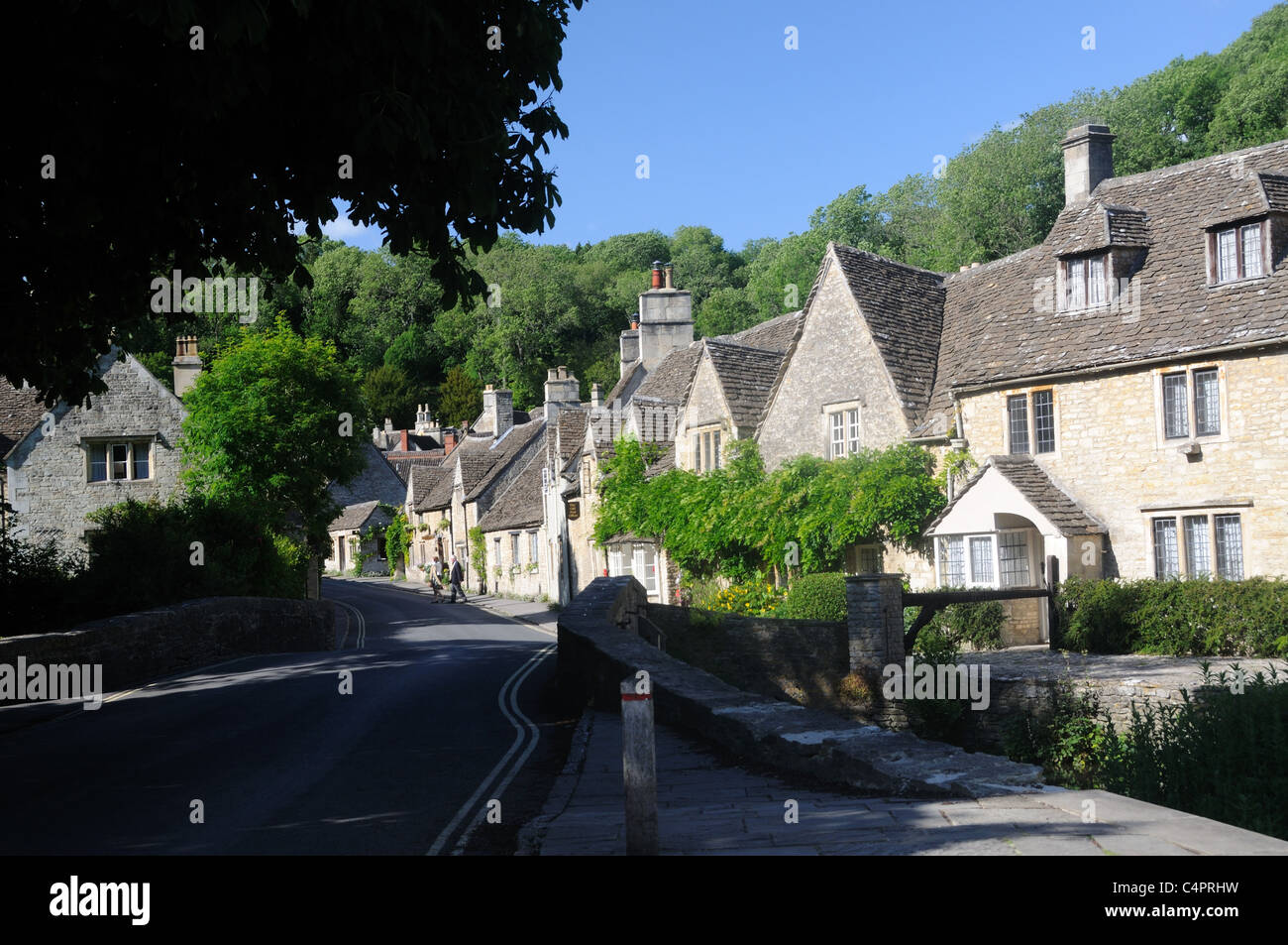 The Town Bridge and Water Street, in the picturesque village of Castle Combe, Wiltshire, England - Stock Image