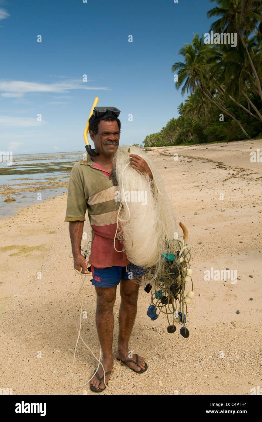 Local Fijian fisherman and fishing gear on beach in Fiji - Stock Image