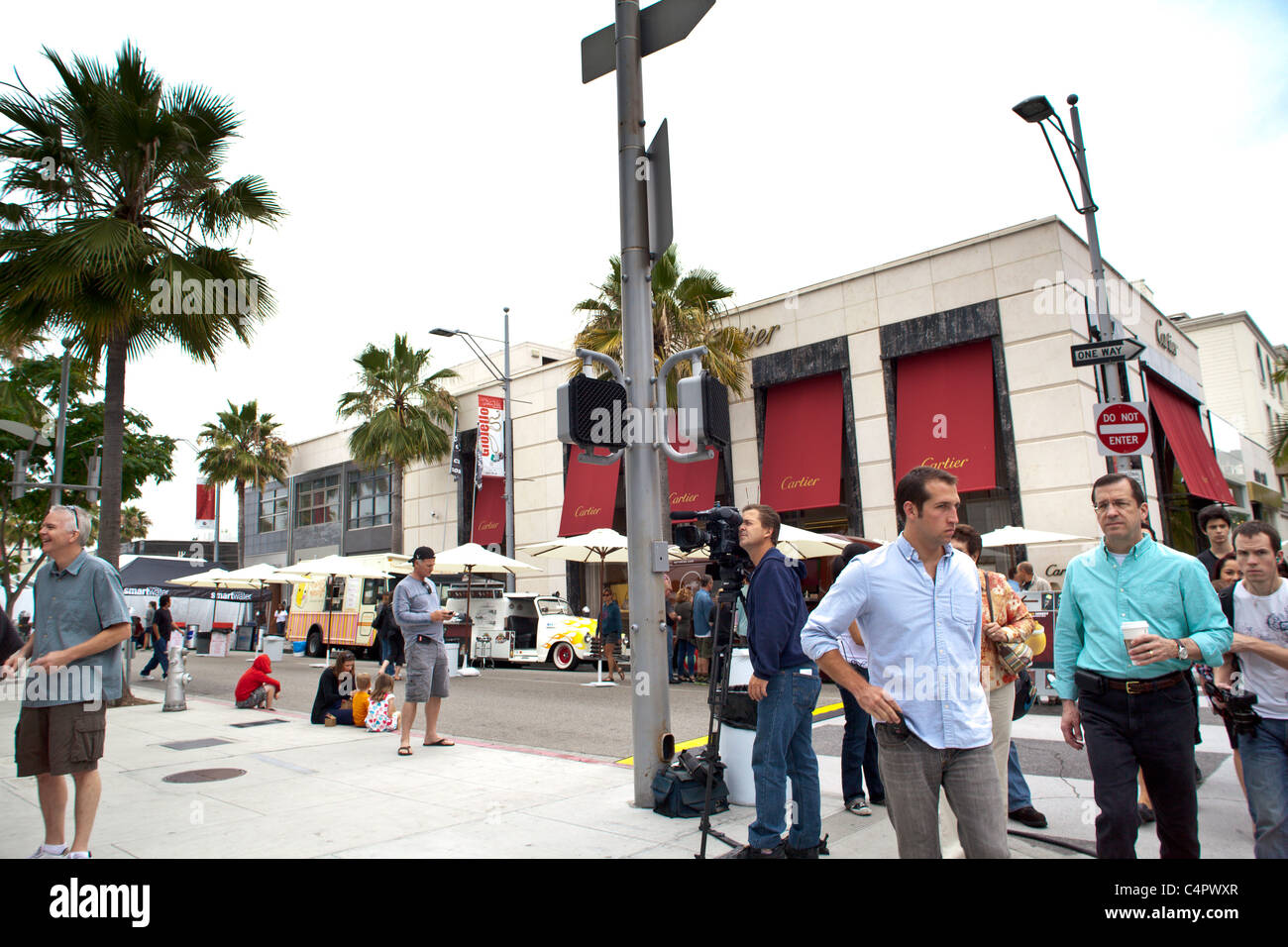 A crowd scene at the 2011 Rodeo Drive Concours with some of the invited food trucks in the background. Stock Photo