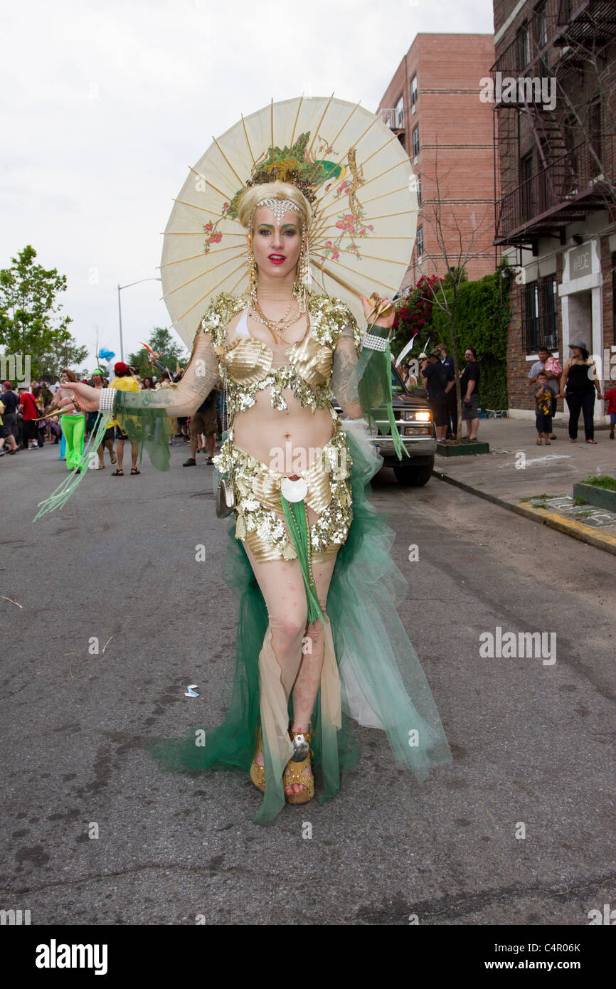 Mermaid in gold lamé costume in the 2011 Mermaid Parade at Coney Island in Brooklyn, New York on June 18, 2011 - Stock Image