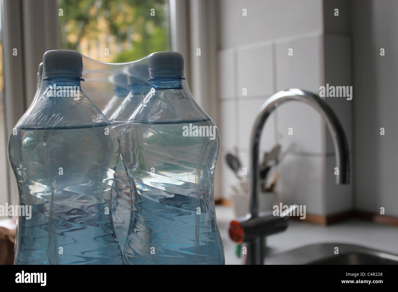 Bottled water or tap water? - Stock Image