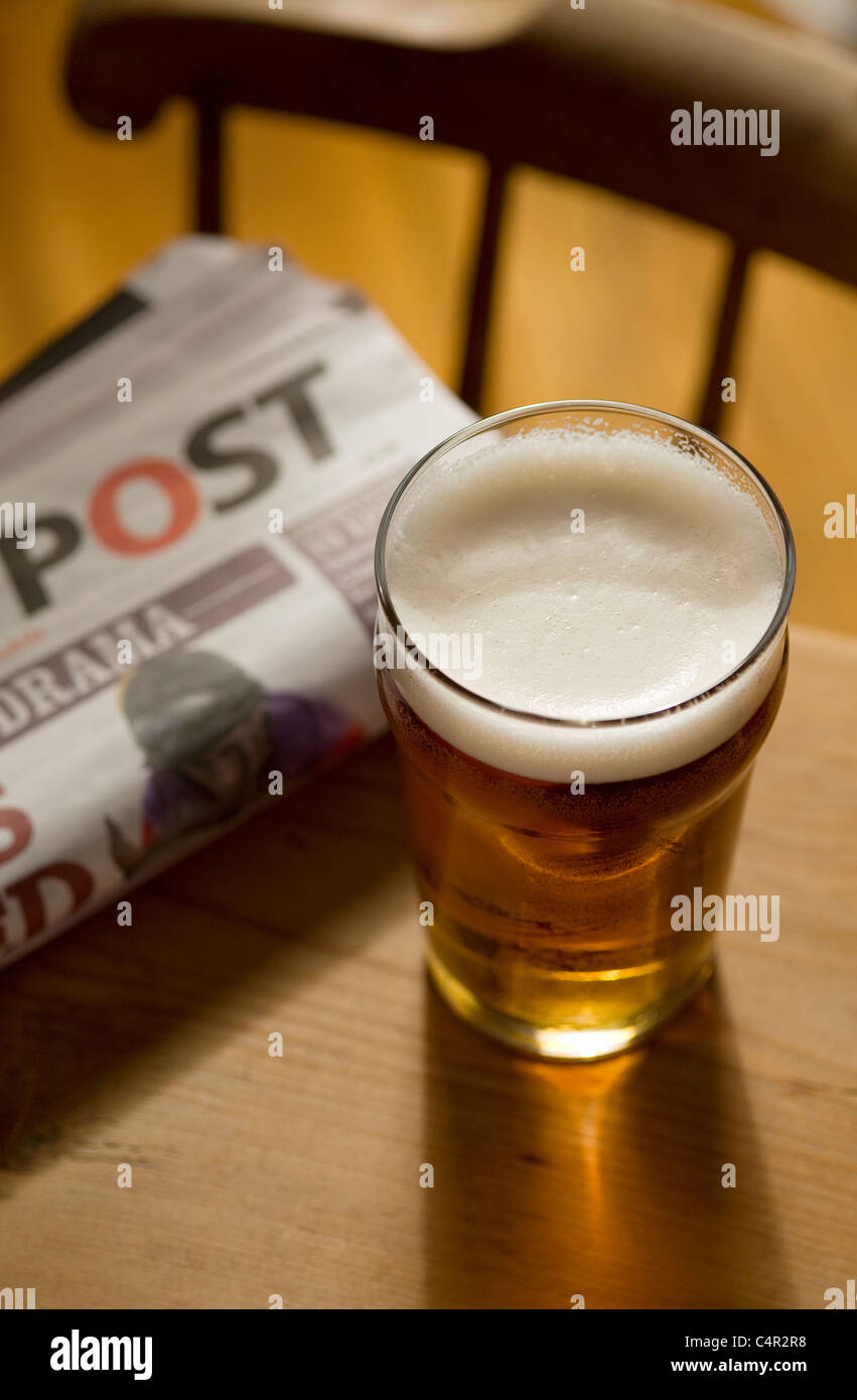pint of british beer on pub table - Stock Image