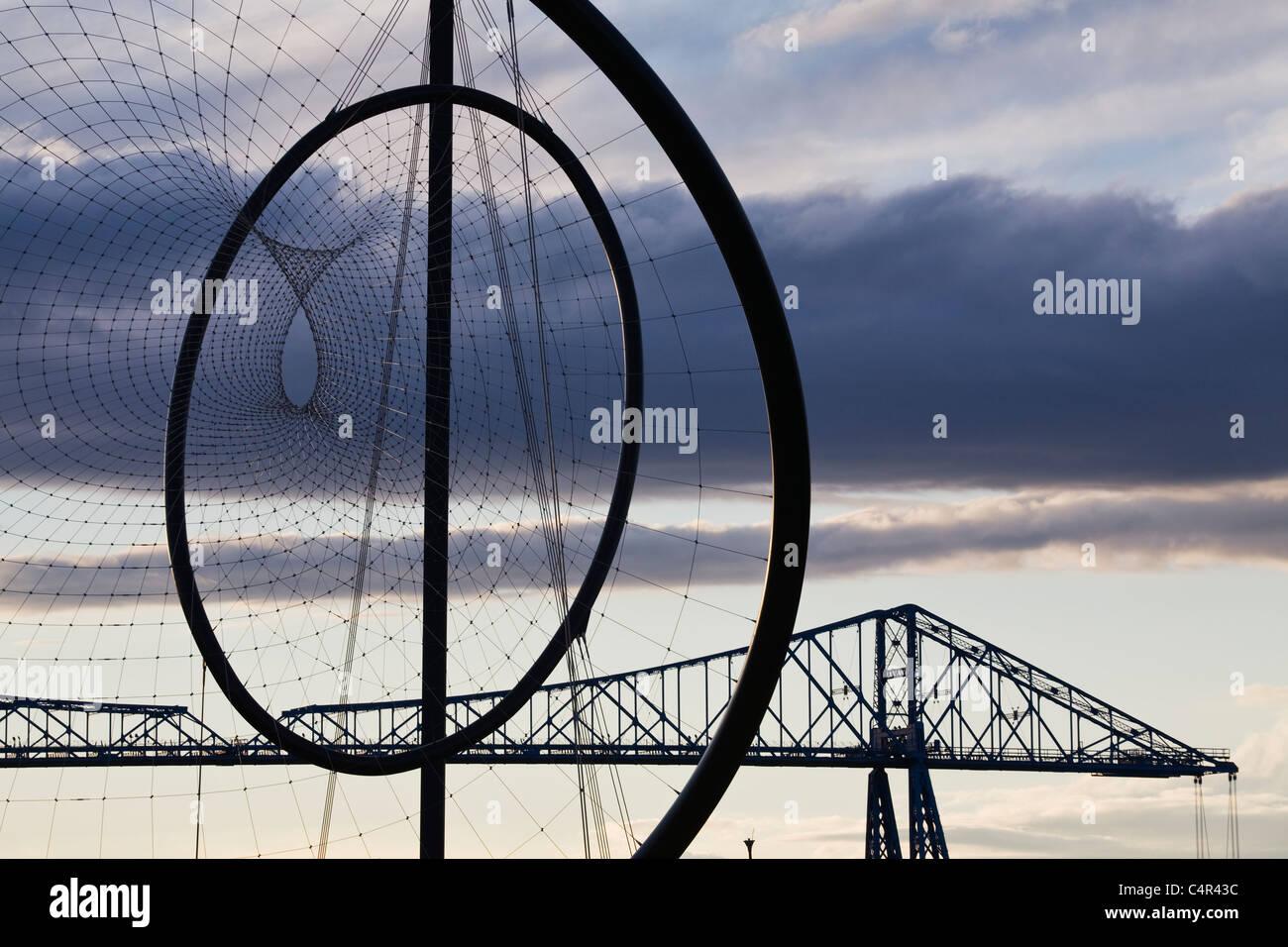 Temenos Sculpture (Kapoor) with Transporter Bridge, Middlesborough, England - Stock Image