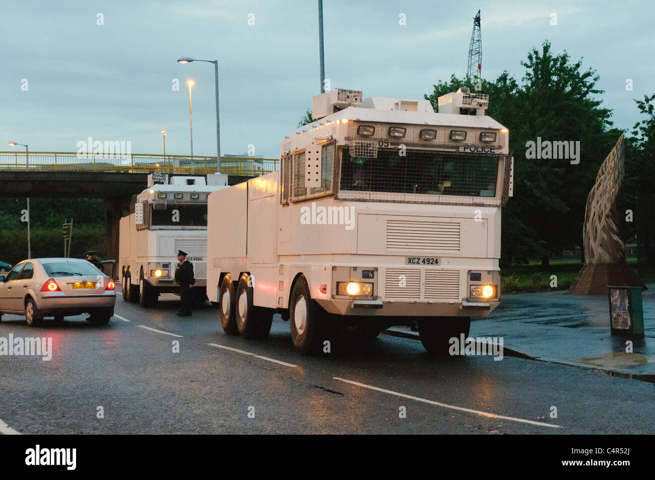 Two PSNI water cannon parked up and waiting to be deployed for crowd control. - Stock Image