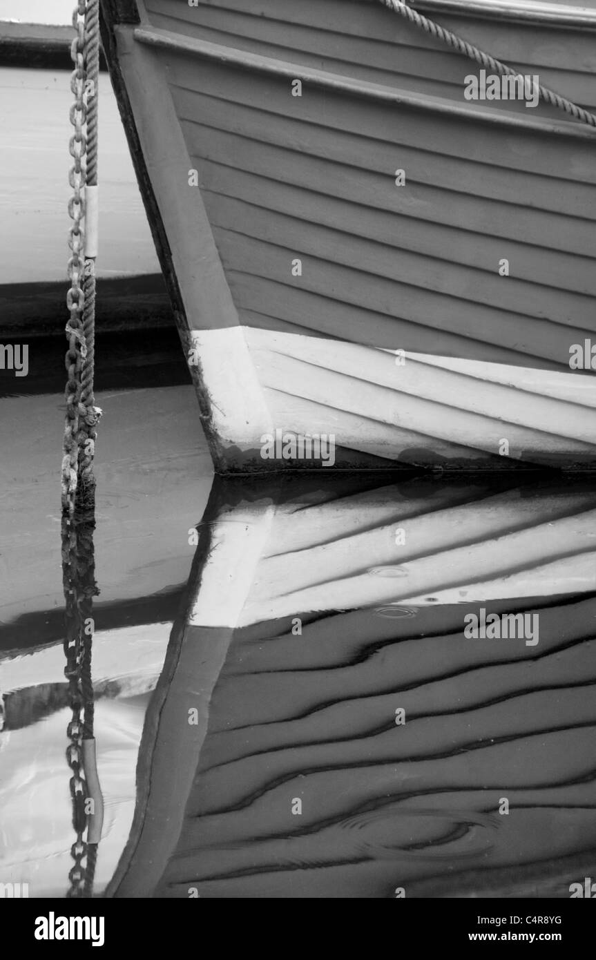Reflection of Wooden Boat in Black and White - Stock Image