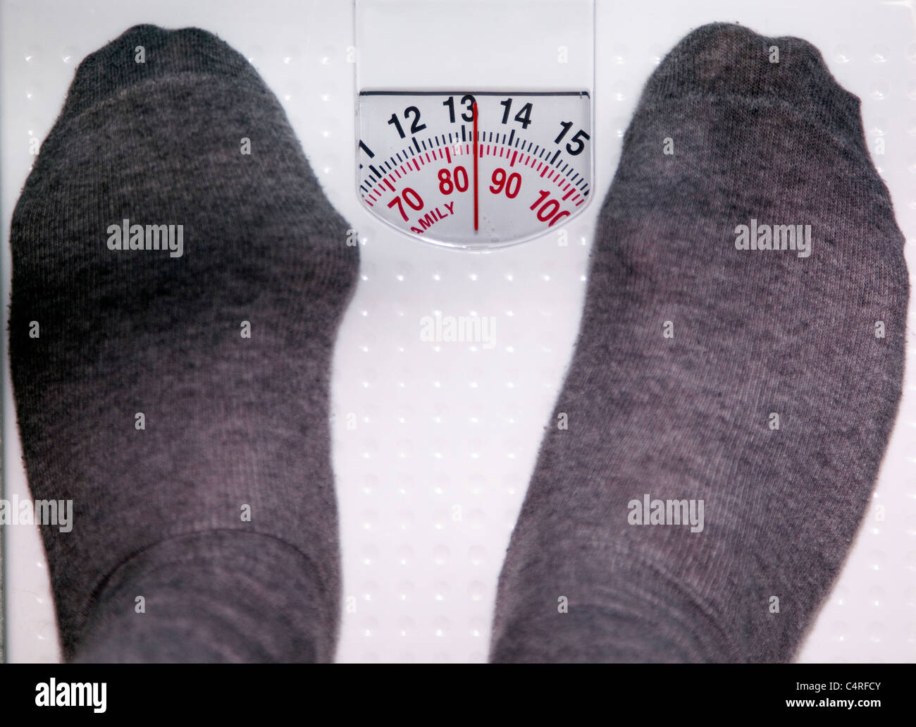 Bathroom Scales, London: Obese Middle Aged Male Weighs In At 85 Kilos:left  Foot Has Bunion Swelling