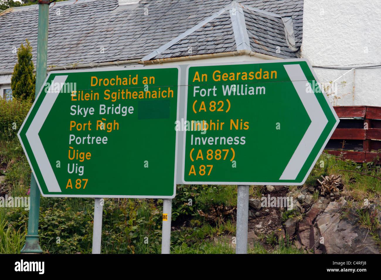 Dual language English and Gaelic road signs in Kyle of Lochalsh, Scotland - Stock Image