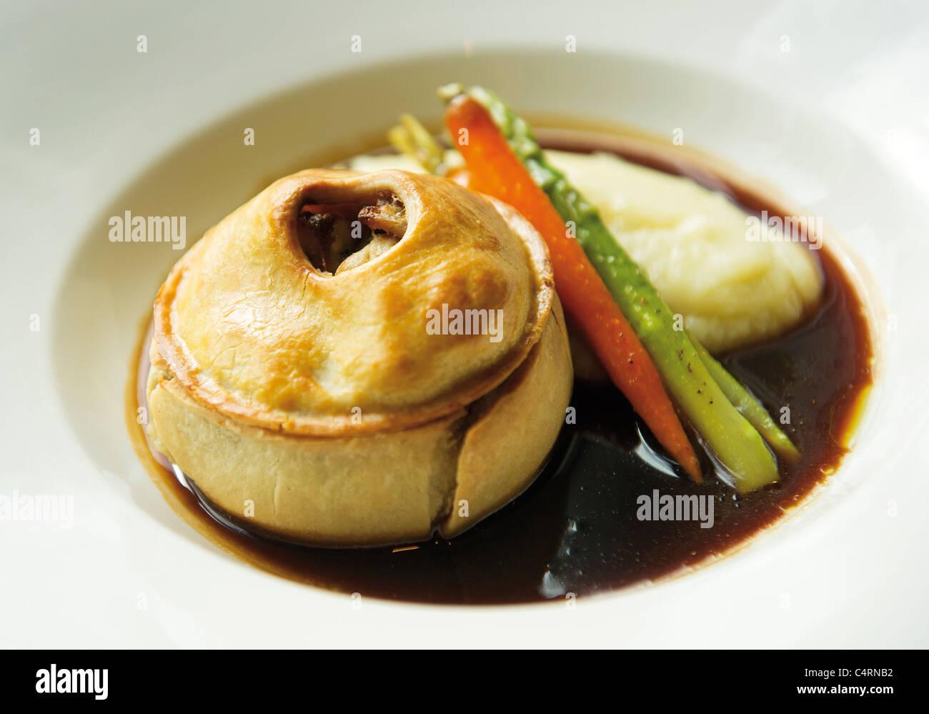 Chicken, ham and mushroom pie dish - Stock Image