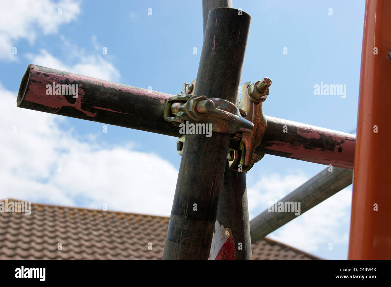scaffolding round a property showing secured fittings - Stock Image