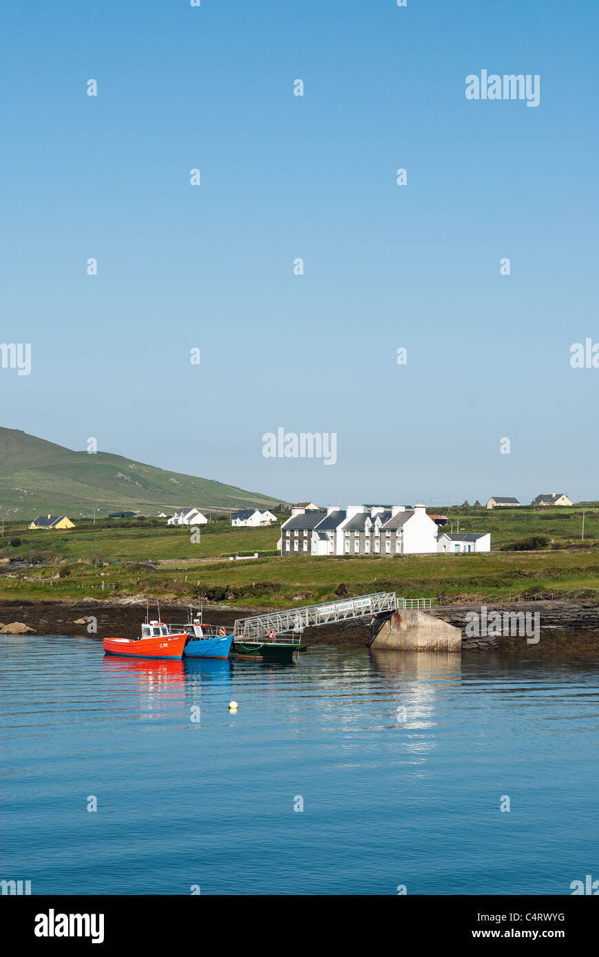 Cottages and jetty on Valentia Island opposite the small harbour of Portmagee Co Kerry, Republic of Ireland Stock Photo