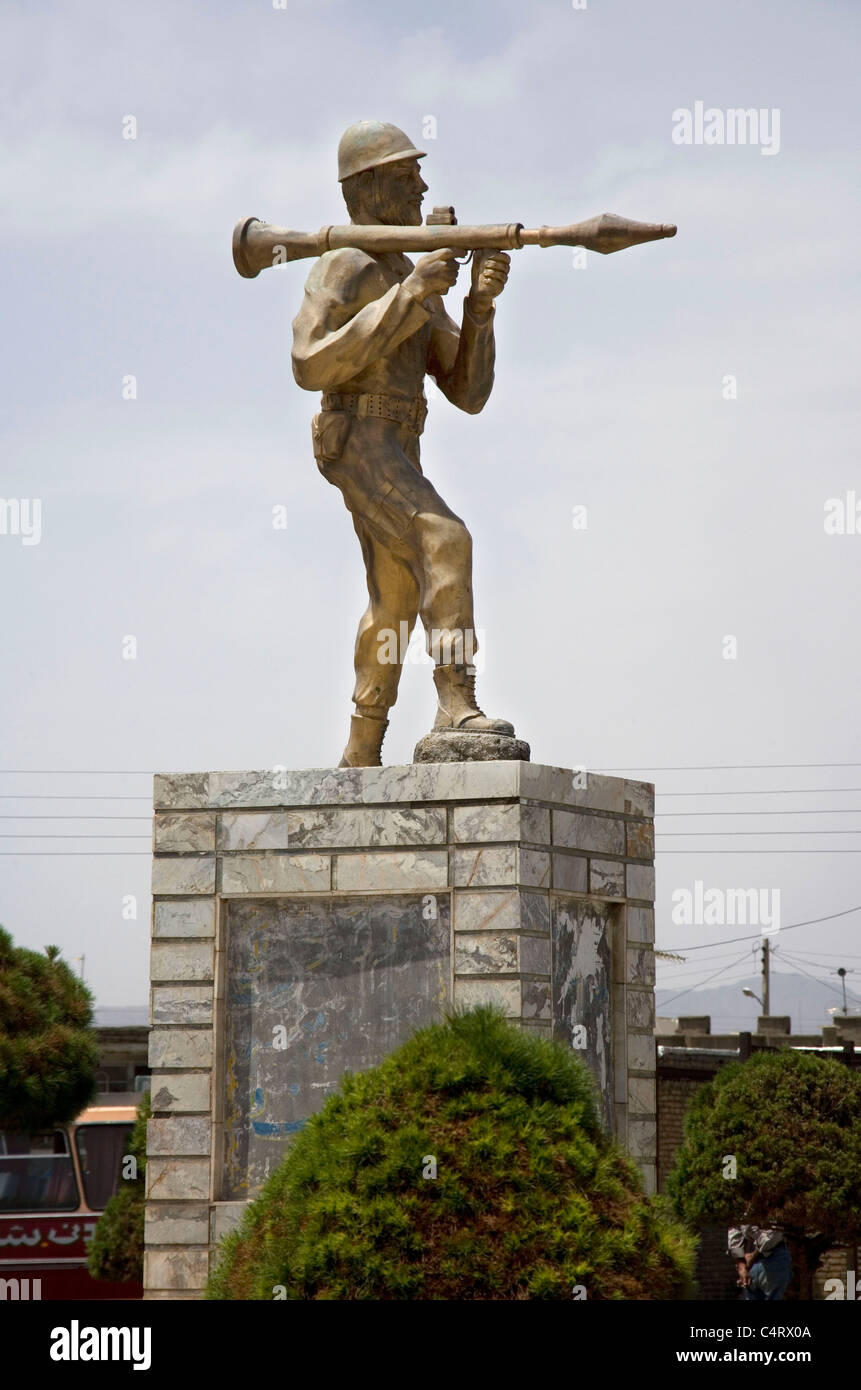Monument of army soldier with rpg rocket launcher near Bardeskan, Iran - Stock Image