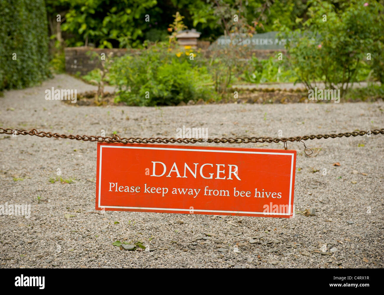Danger warning sign. Please keep away from bee hives. - Stock Image