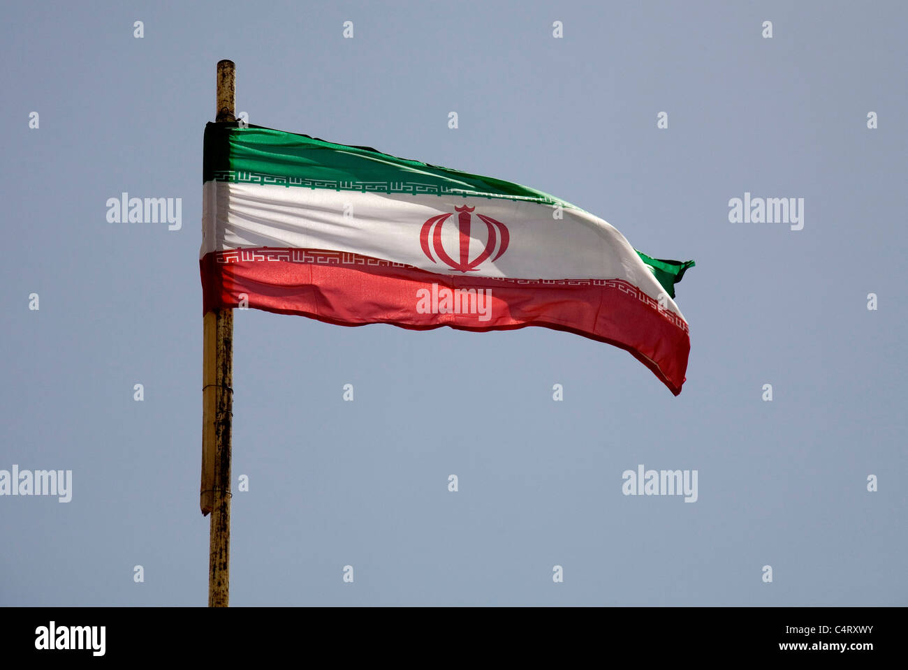 Iranian flag waving in Soltaniyeh, near Zanjan, Iran - Stock Image