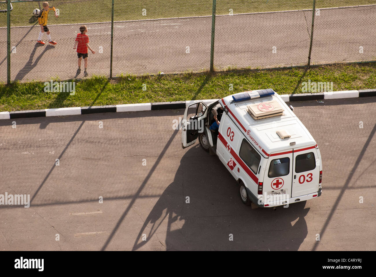 Ambulance car close to the soccer stadium during the match - Stock Image
