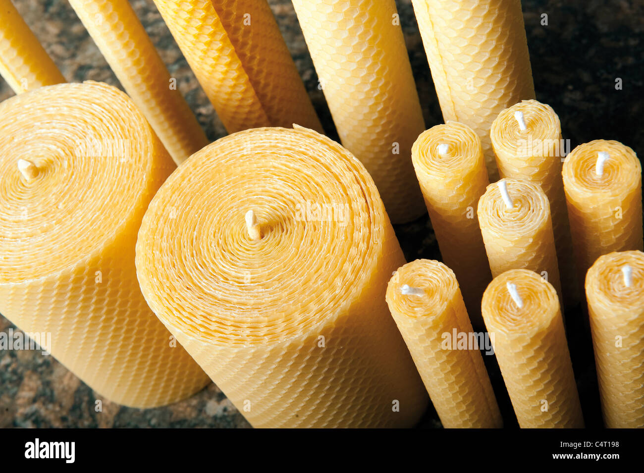 A selection of beeswax candles candle traditional hand made wax wick bee - Stock Image