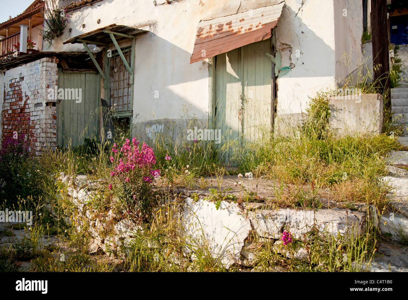 dilapidated house in the small mountain village Glossa, Skopelos Island, Northern Sporades, Greece - Stock Image