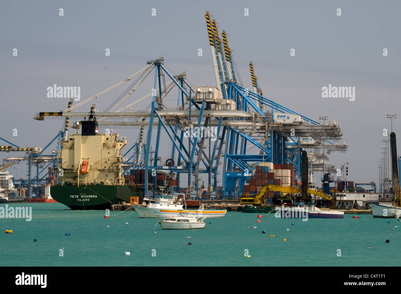 The container ship Tete Rickmers is docked at freeport, Malta to load and load its containers - Stock Image