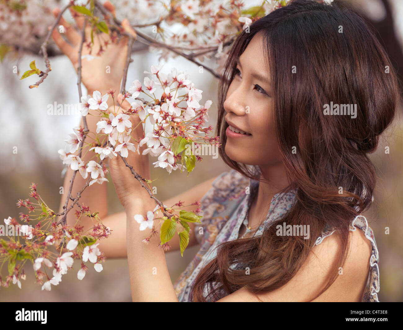 Portrait Of A Beautiful Young Smiling Asian Woman Standing
