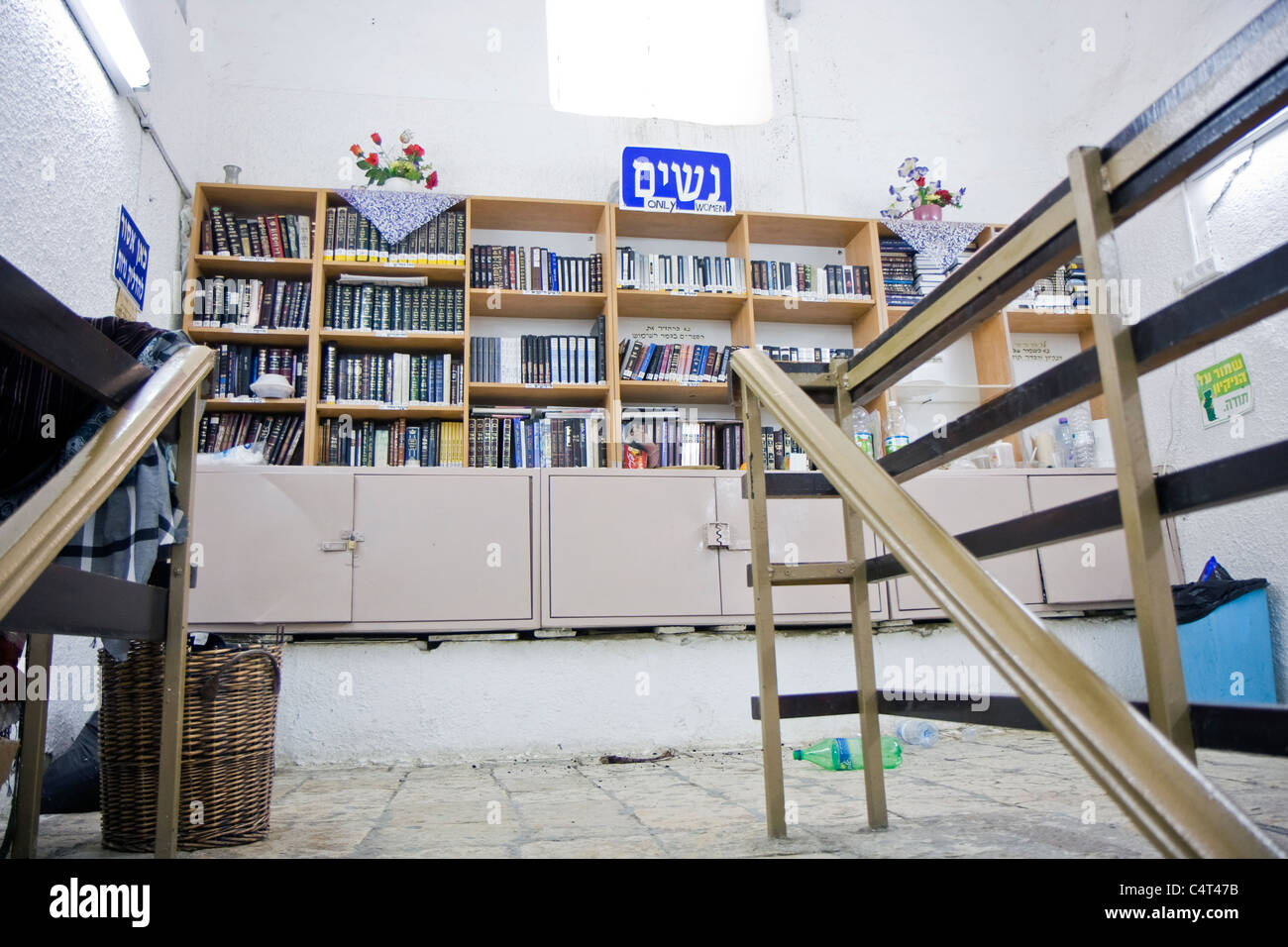 Women's part in a synagogue located at Nebi Samuel tomb next to Jerusalem. Closet with religious books and signs - Stock Image