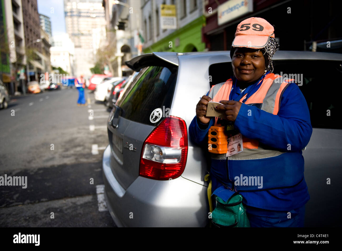 Marshal collecting parking fee in Cape Town South Africa - Stock Image