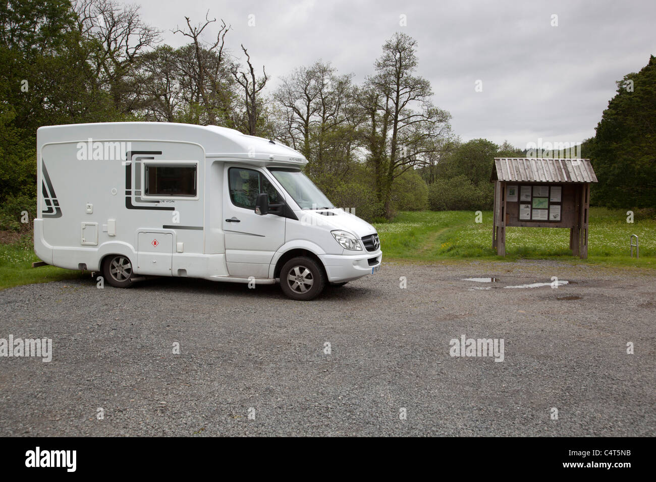 Camper Van parked at Wood of Cree; Dumfries and Galloway; Scotland - Stock Image