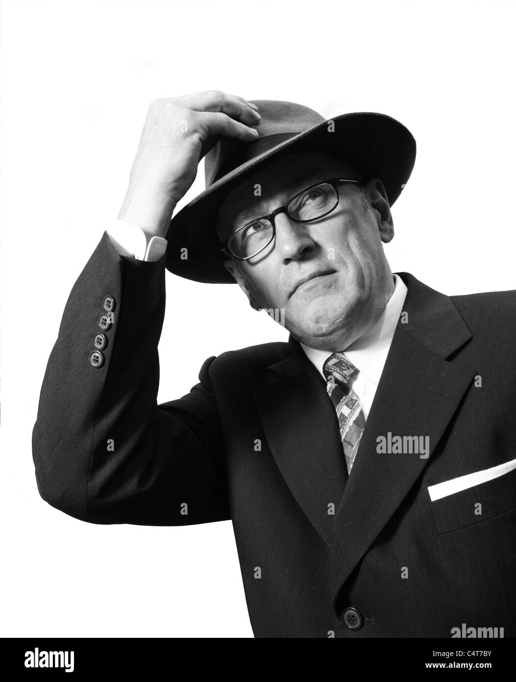 Old fashioned 1940-1950s gentleman wearing a Trilby or Fedora hat and  Spectacles 240d4fbf701