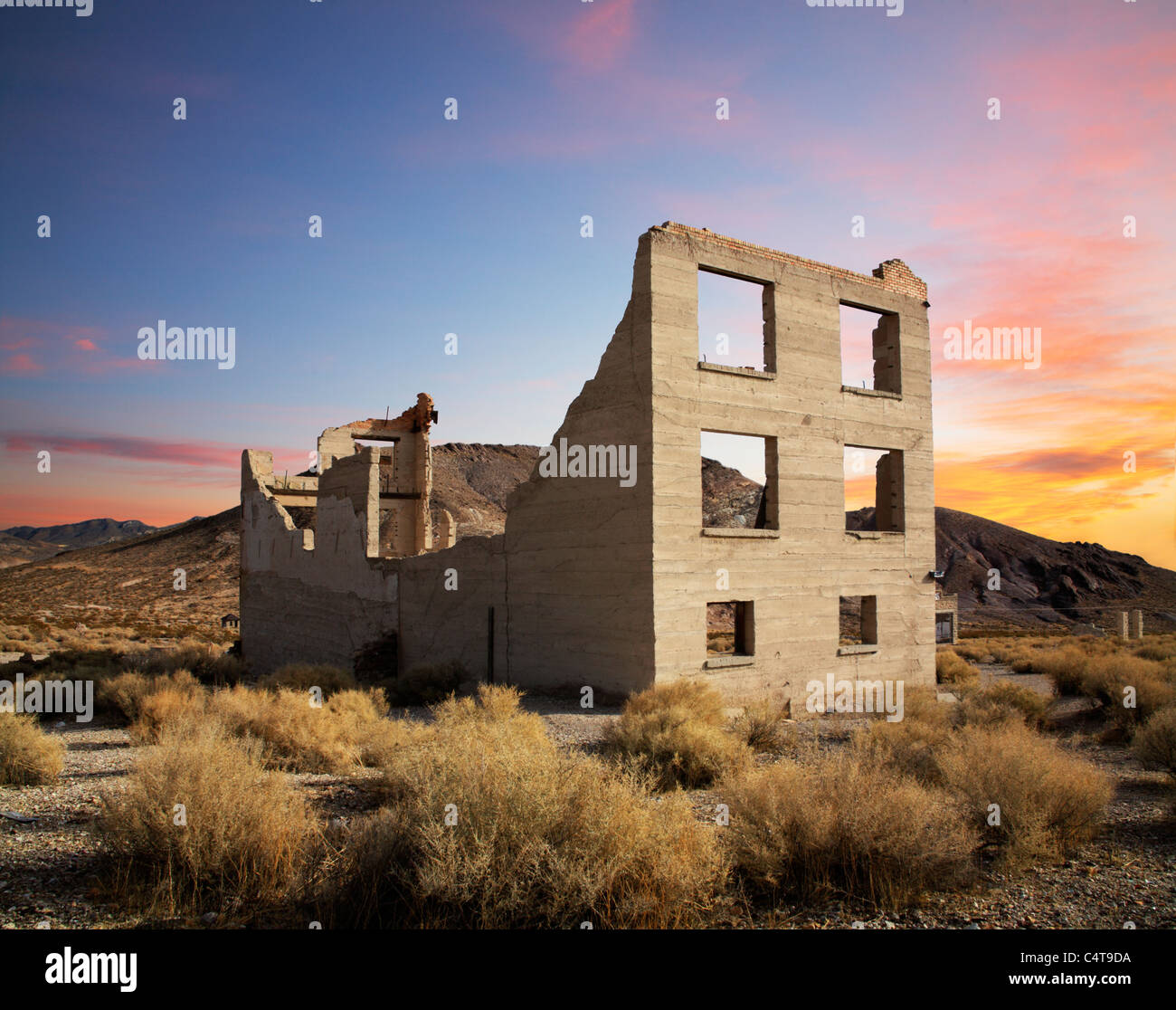 The Remnant Of A Bygone Era, Sunset Over A Crumbling Building At Rhyolite Nevada, An Abandoned Town Near Death Valley - Stock Image