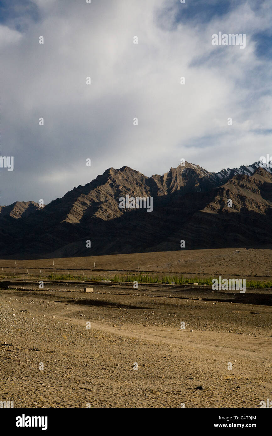 Near Leh, Ladakh in northern India are the Himalayas with snow-capped mountains surrounding arid, barren cold desert; - Stock Image