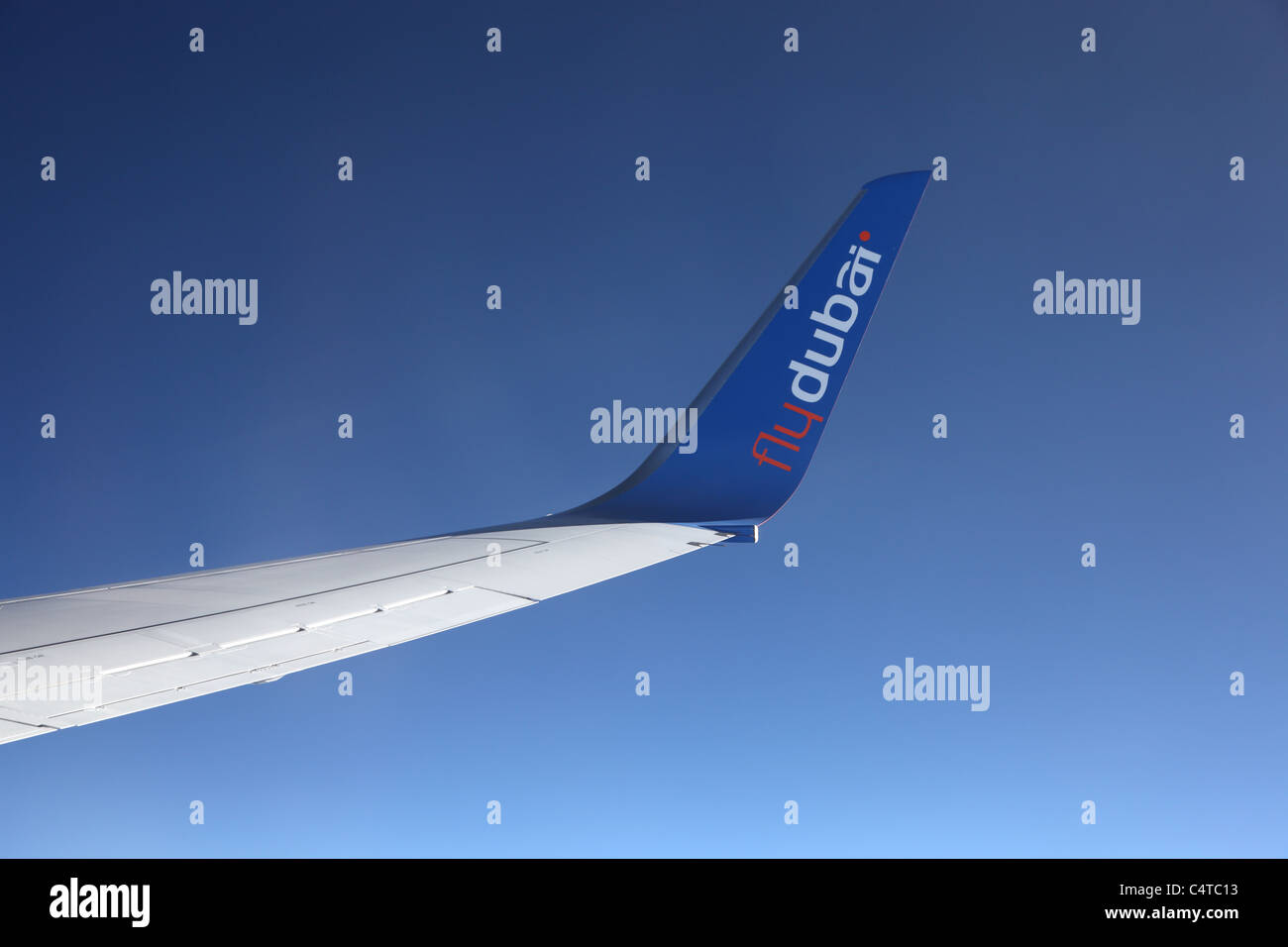 Wing of the FlyDubai airplane during a flight. Photo taken at 26th of Mai 2011 - Stock Image