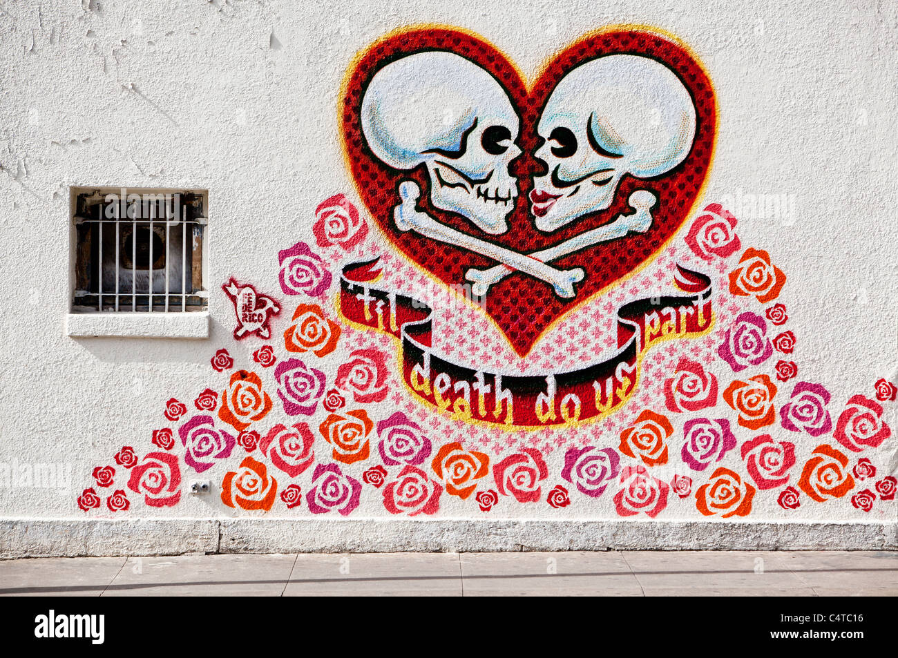 Austin Texas - A mural on the wall of the Mexic-Arte Museum by artist Federico Archuletta -  Til Death Do us Part  & Austin Texas - A mural on the wall of the Mexic-Arte Museum by ...
