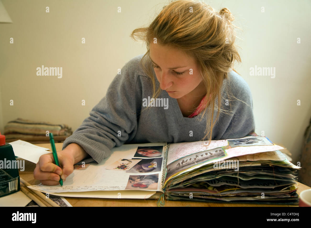 Model released image of teenage girl working on her art folder - Stock Image