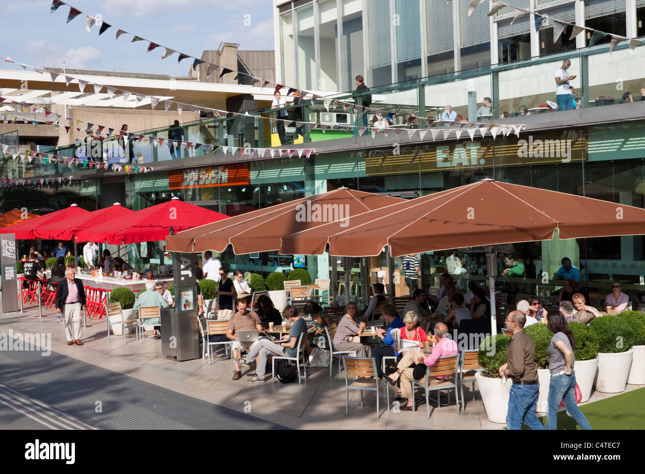 People enjoying the bars and restaurants by the Royal Festival Hall, South Bank, London, England, UK - Stock Image