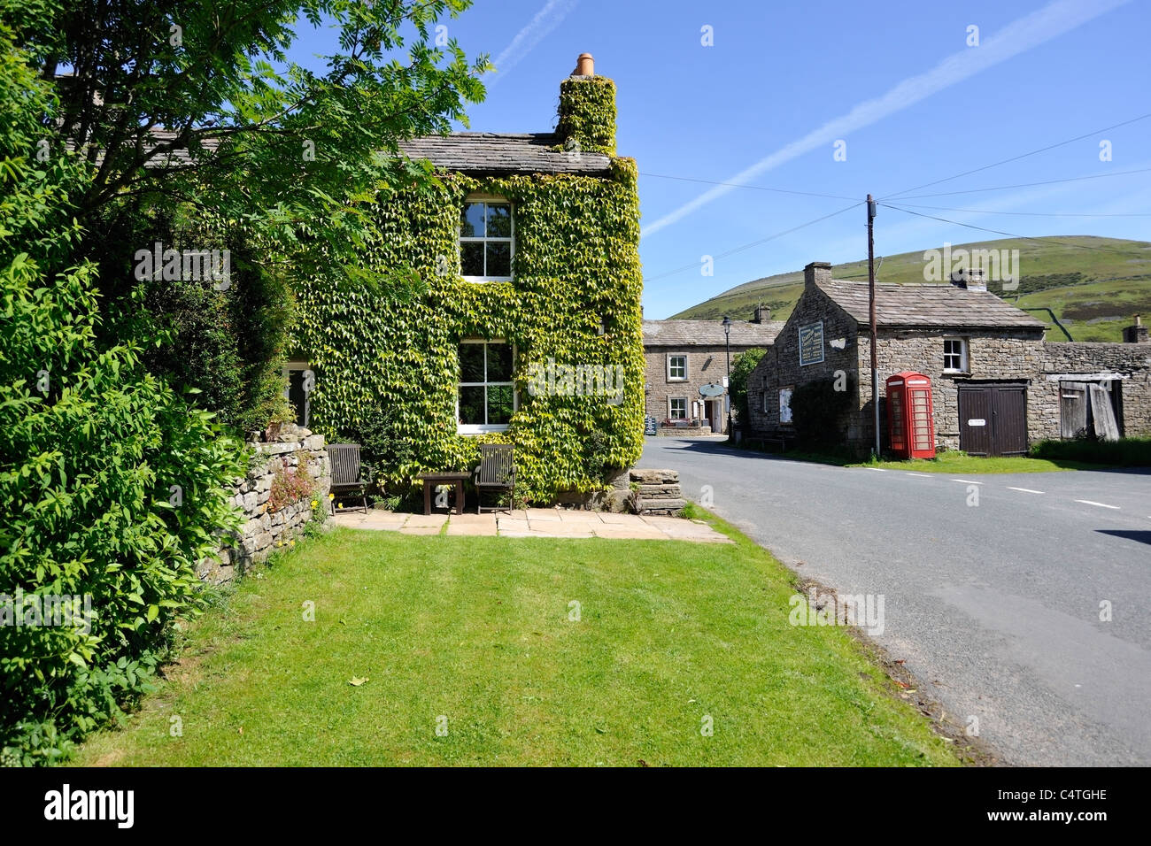 Historic red telephone box in the village of  Thwaite, Swaledale, Yorkshire, England - Stock Image