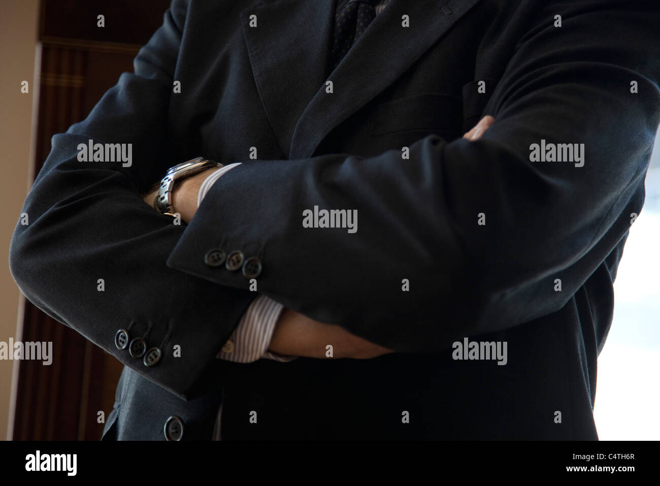 Executive with arms folded, cropped - Stock Image