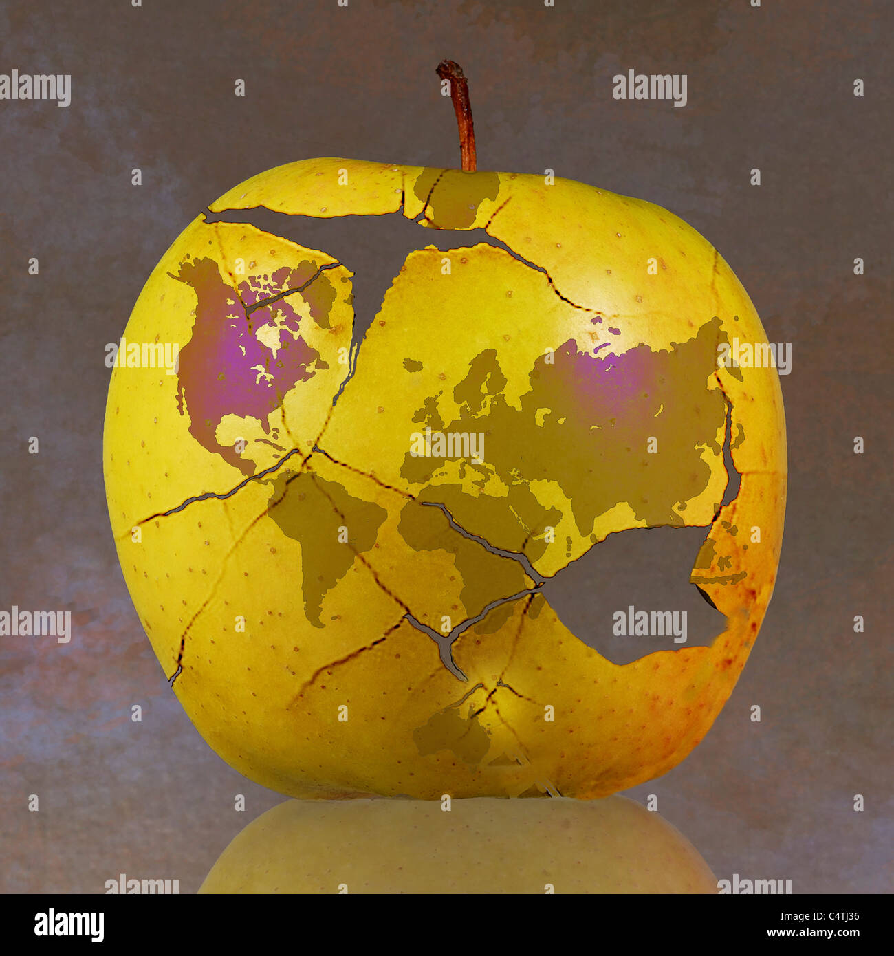 World map on fractured apple - Stock Image