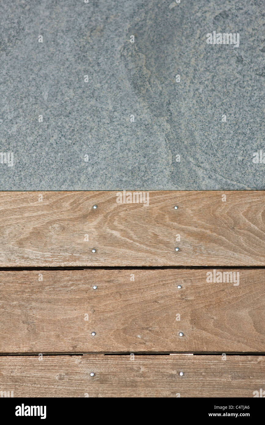 Wooden flooring and paving stone - Stock Image