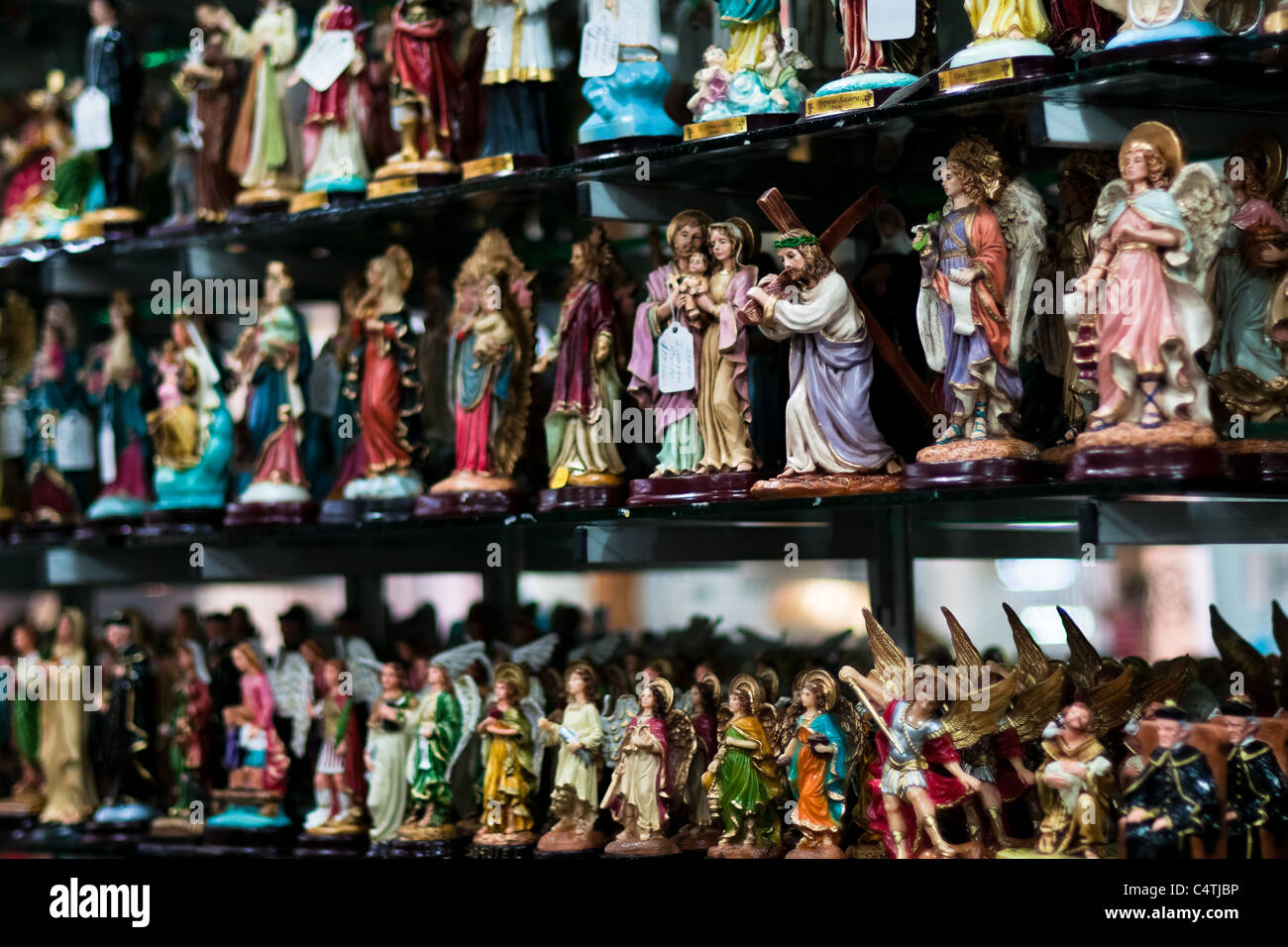 Catholic devotional objects for sale in a religious shop in Bogota, Colombia. - Stock Image
