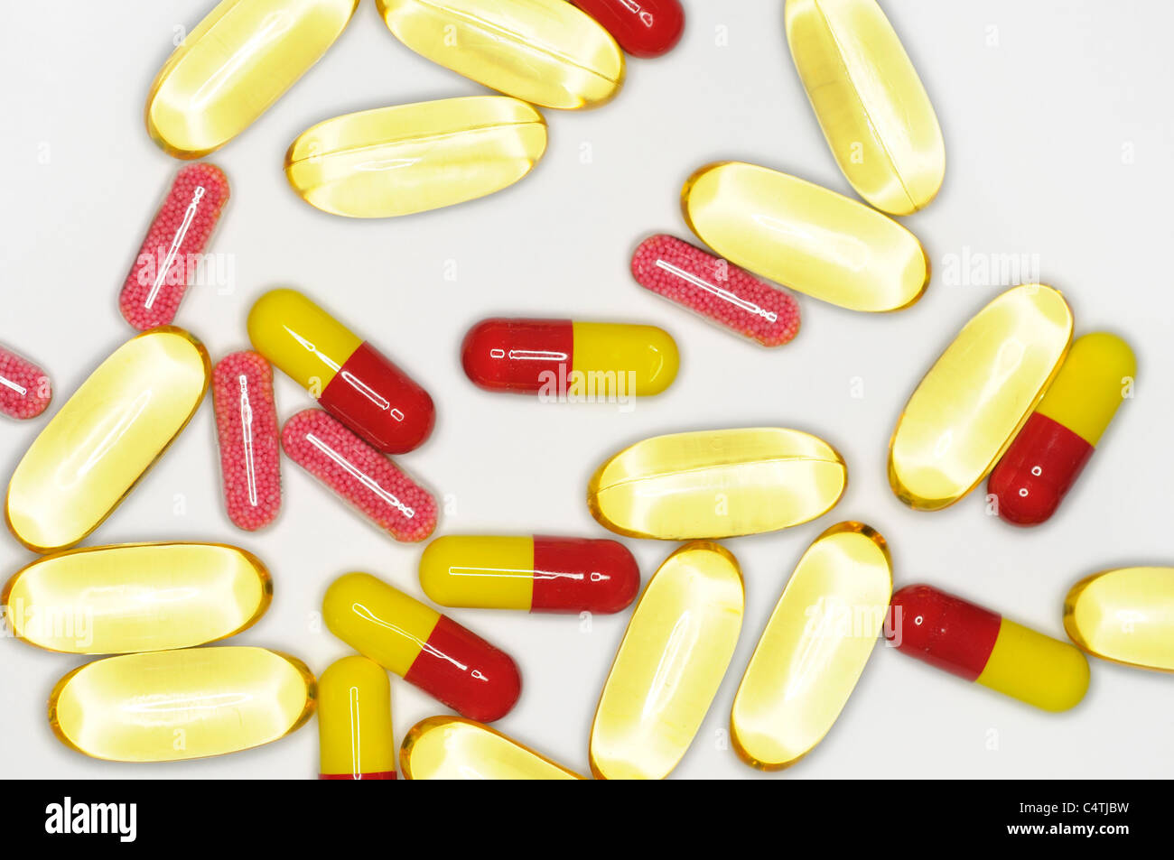 Variety of pills in capsule form - Stock Image