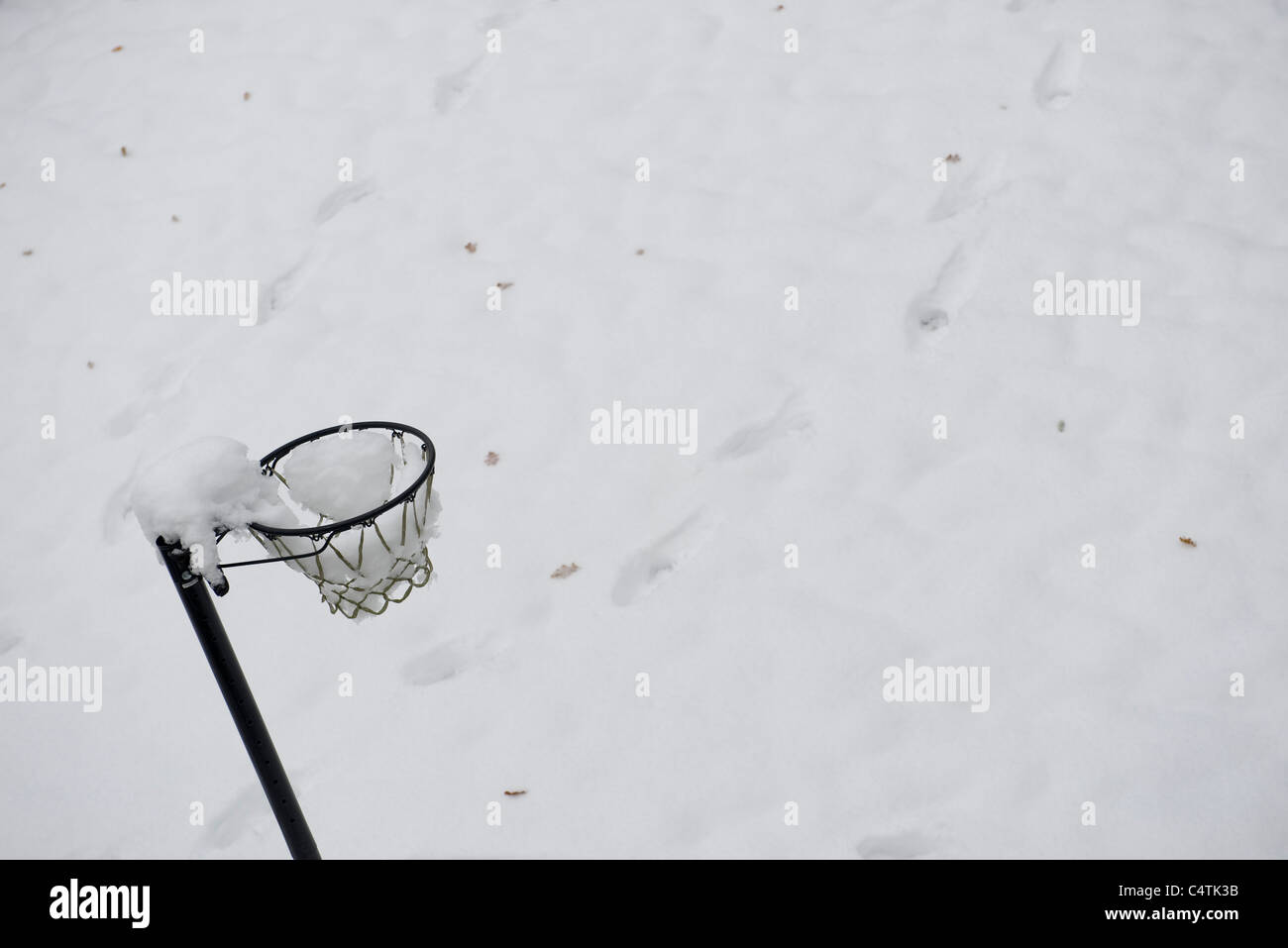 Basketball hoop covered in snow Stock Photo