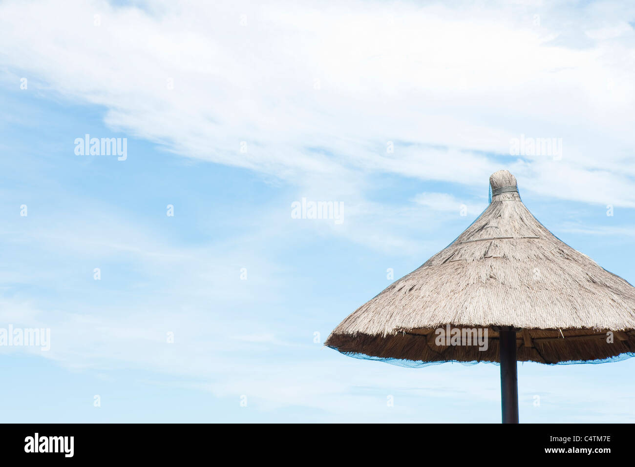 Thatched parasol - Stock Image