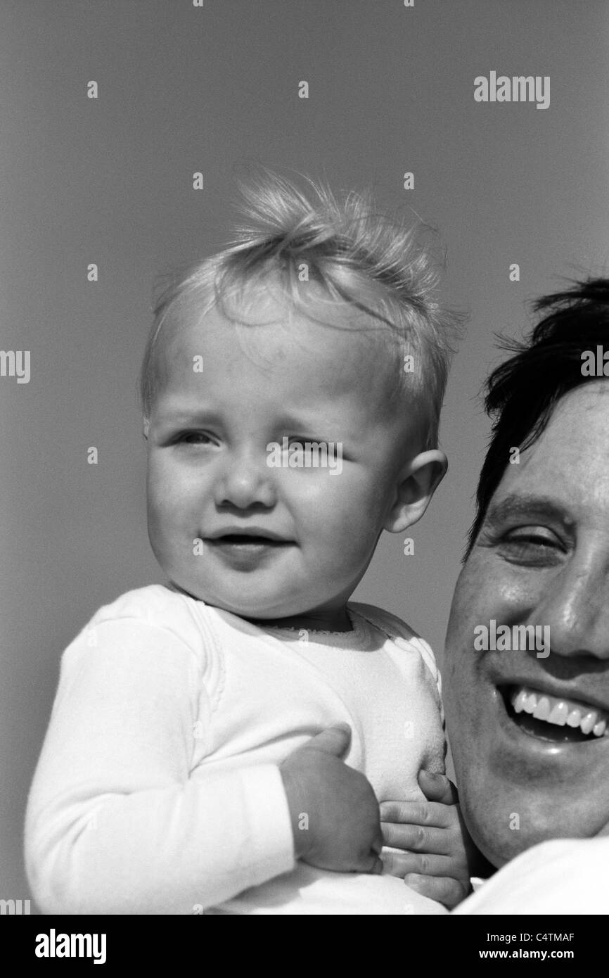 happy boy with dad black and white - Stock Image