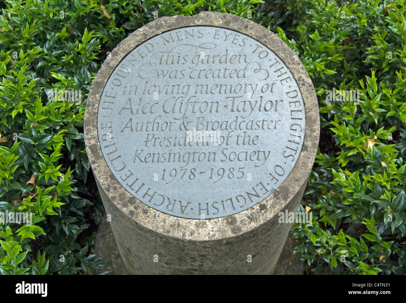 memorial stone to alec clifton-taylor, writer and broadcaster, and inspiration for the garden in which the memorial - Stock Image