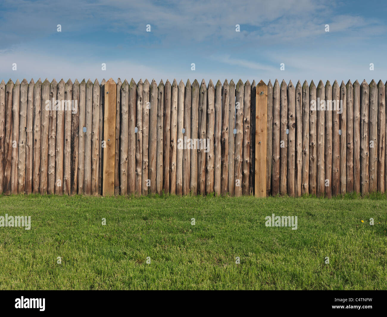 Palisade wall of a fort - Stock Image