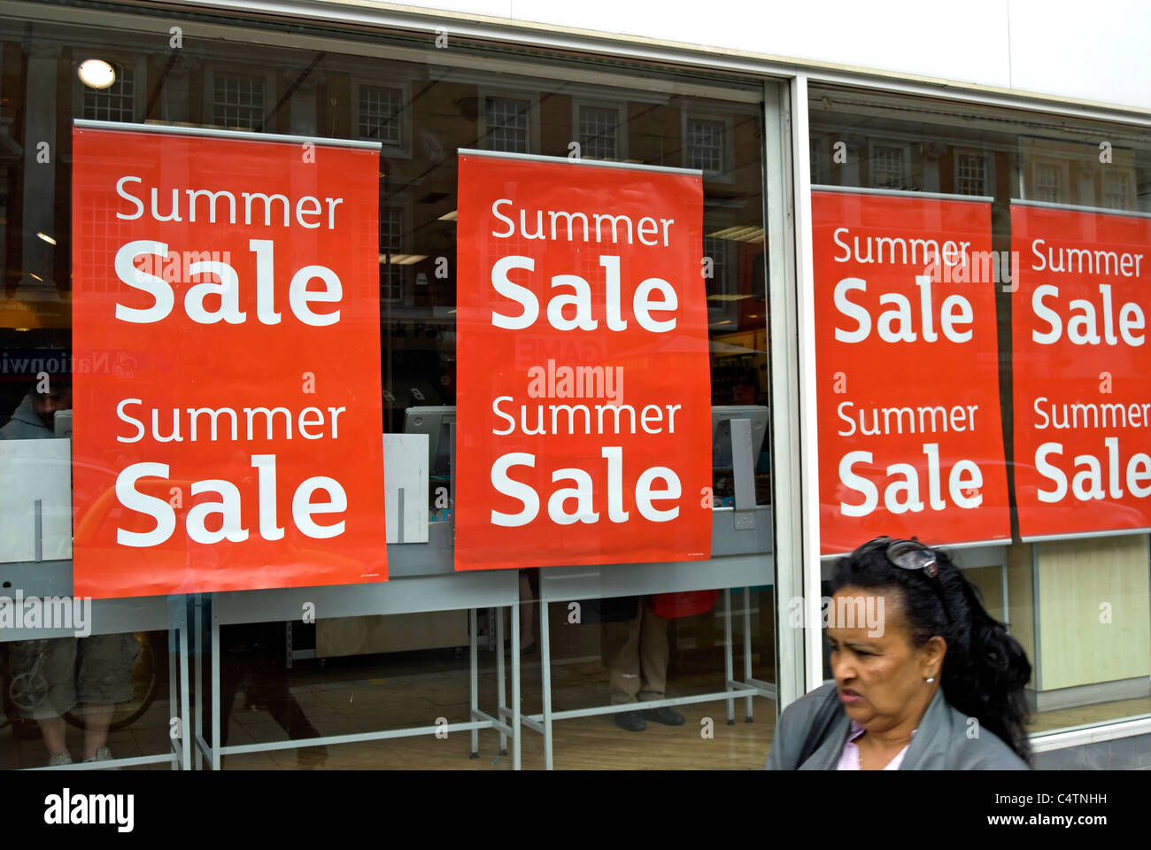 summer sale signs on a window of a branch of argos on kensington high street, london, england - Stock Image