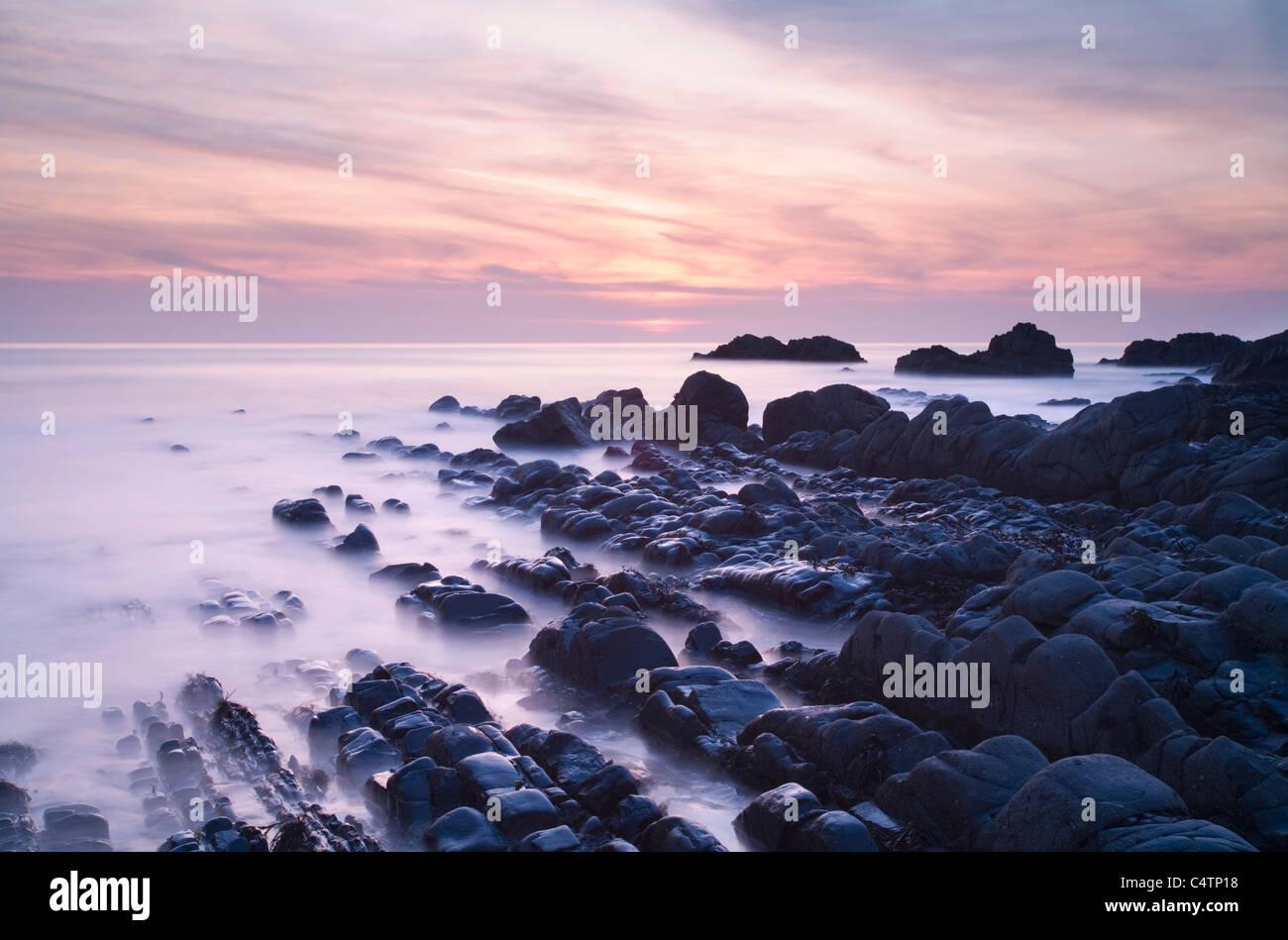 Rocky shoreline at Sunset at Hartland Quay. Devon. England. UK. - Stock Image