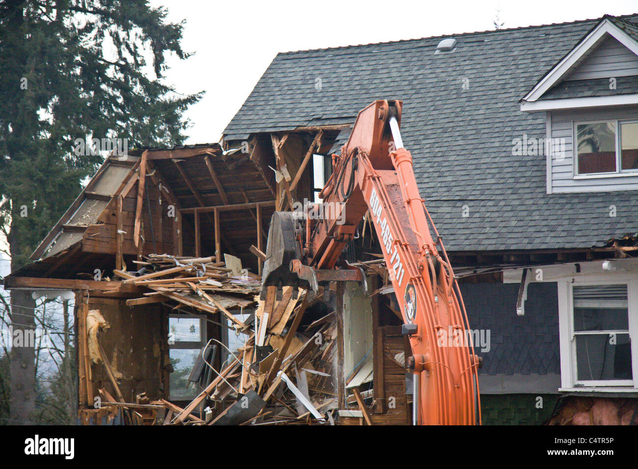 98 year old home being demolished to make way for a newer building - Stock Image
